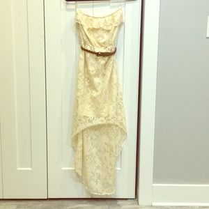 Cream color lace dress with brown twist belt.